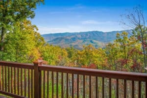 deck of Dancing Bear Lodge cabin with view of fall foliage