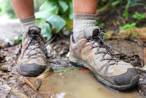 Hiker's hiking boots in a muddy puddle in the Smokies