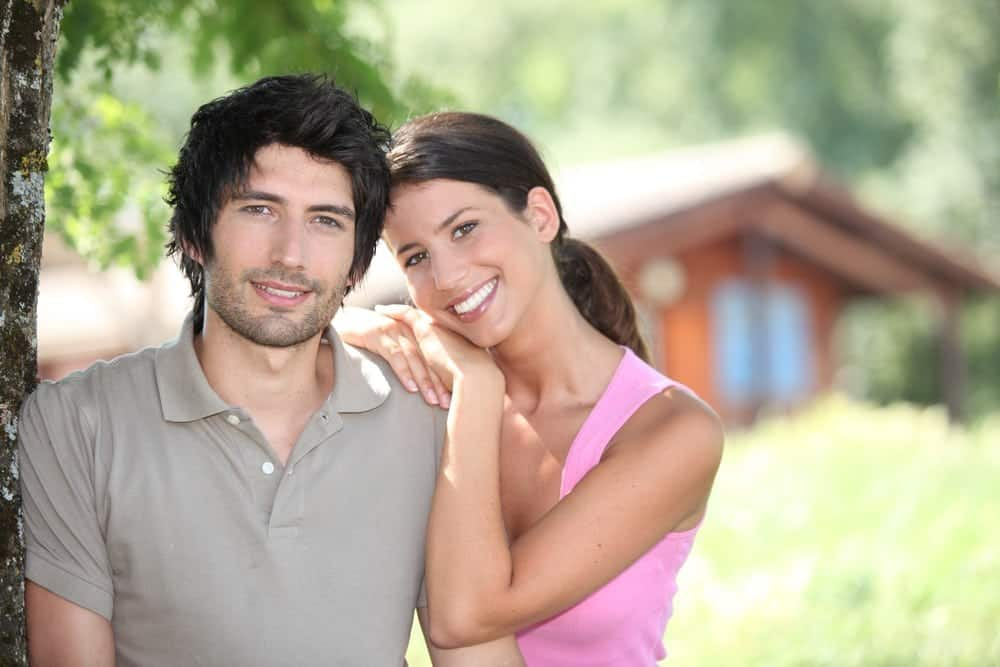 Couple standing in front of their cabin.jpg