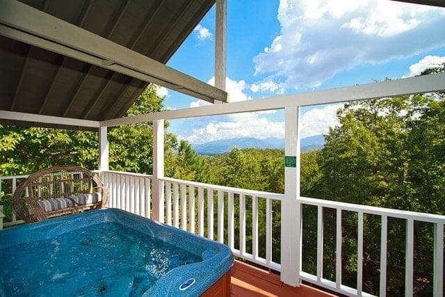 hot tub on deck with an incredible Smoky Mountain view