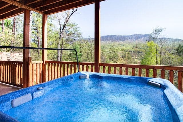 View from the hot tub at Morning Breeze, one of our Gatlinburg TN mountain cabins near a golf course.