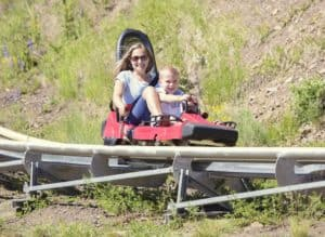 Mother and son riding a mountain coaster.