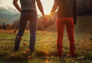 couple holding hands looking at mountains near 1 bedroom cabin in Gatlinburg Tn
