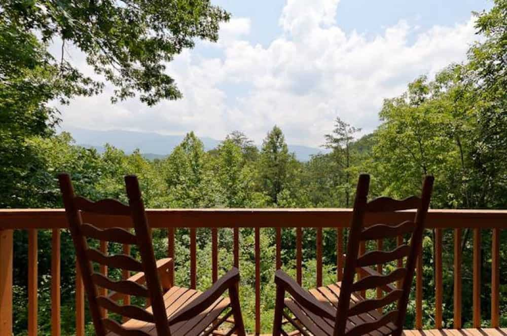mountain view from the deck of a smoky mountain cabin